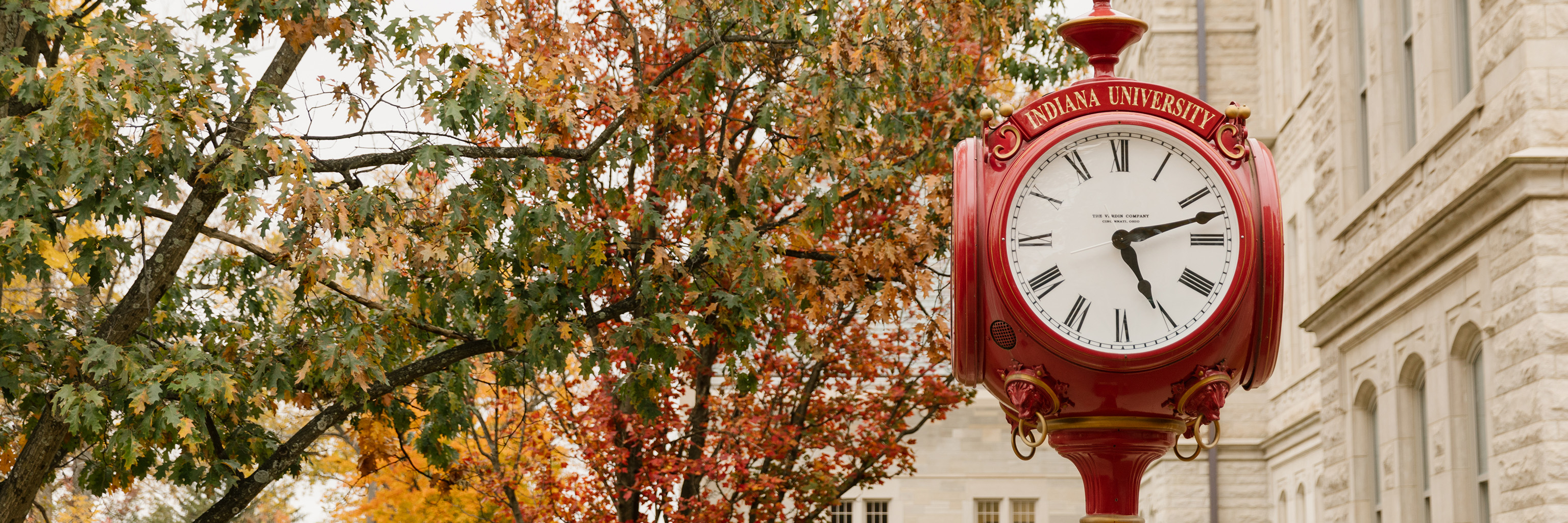 Red Indiana University street post clock