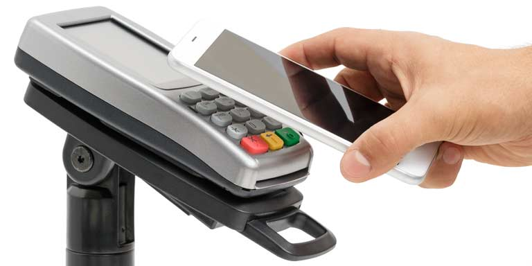 Smartphone being held above a payment terminal