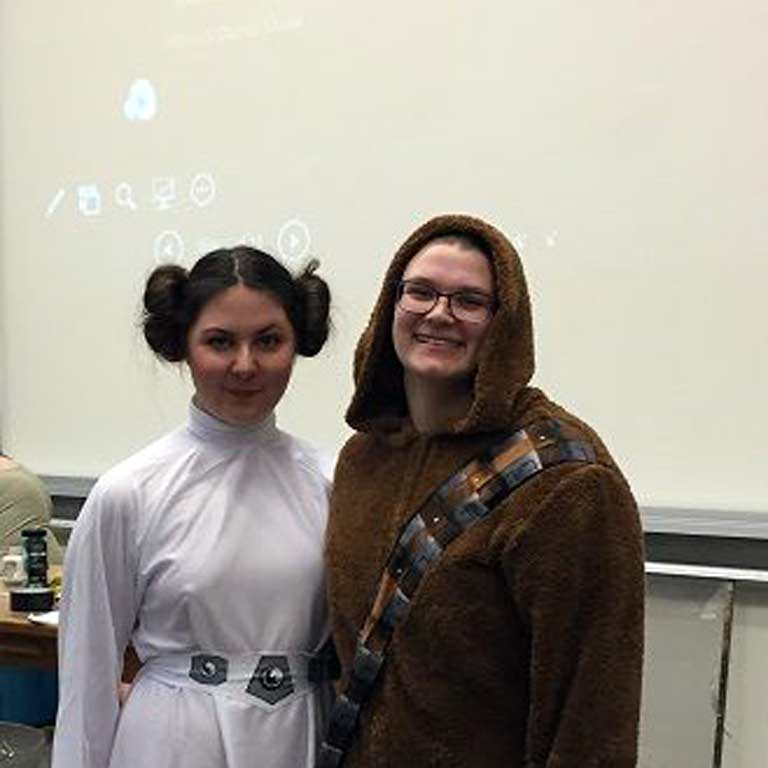 Two students dressed up in Star Wars costumes.